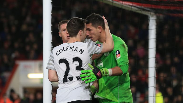 Seamus Coleman congratulates Joel Robles after his penalty save