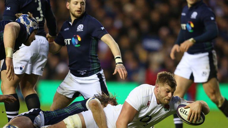 George Kruis powers through the Scotland defence to score