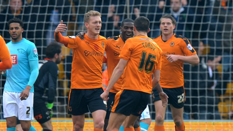 George Saville celebrates after scoring the first goal of the game at Molineux