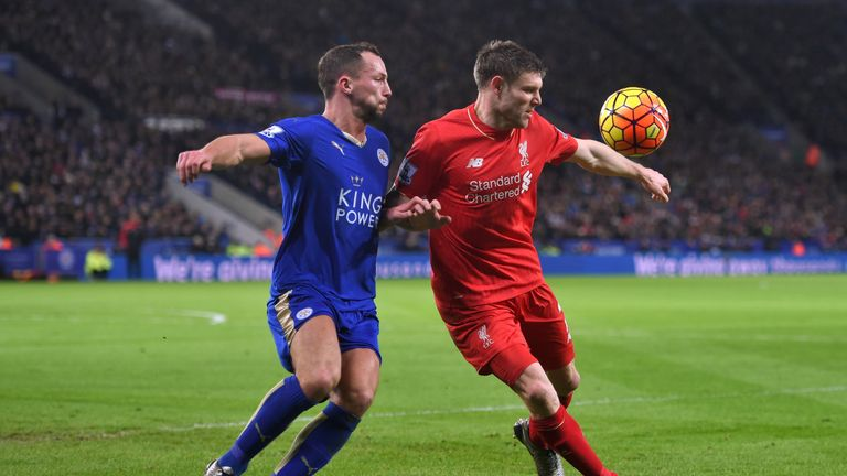 Liverpool's James Milner and Danny Drinkwater of Leicester compete for the ball