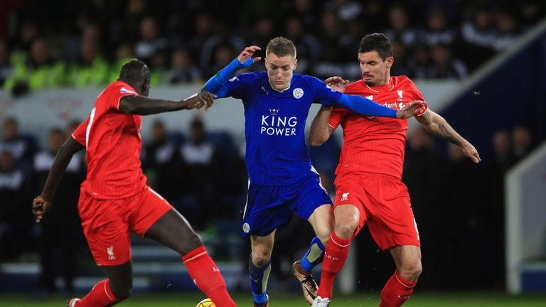 Vardy (middle) battles for the ball with Dejan Lovren (right) and Mamadou Sakho