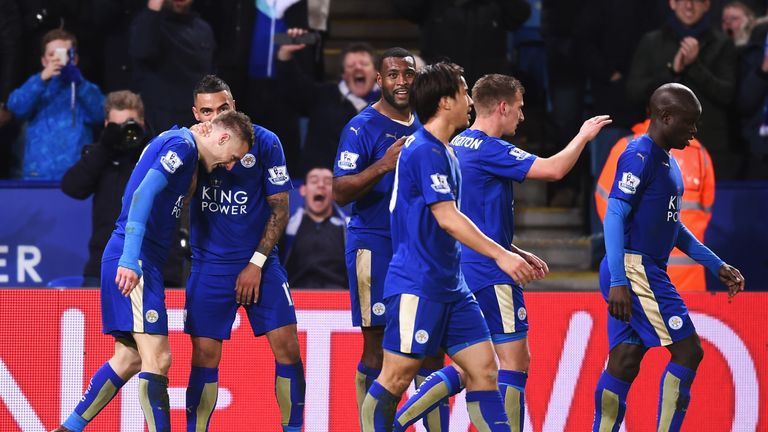 Jamie Vardy (left) celebrates scoring Leicester's first goal with his team-mates