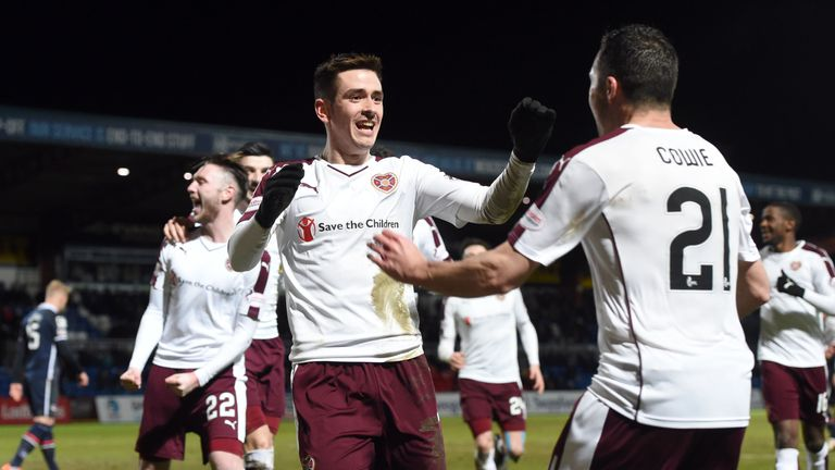 Jamie Walker (centre) put Hearts into the lead thanks to a fortunate deflection