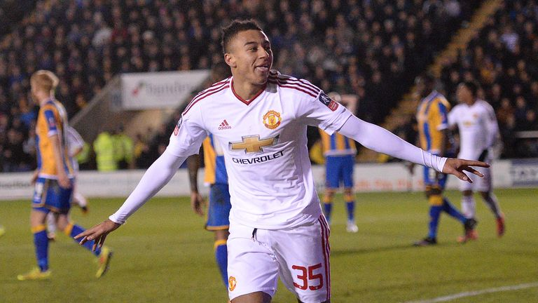 Manchester United's Jesse Lingard celebrates scoring his team's third goal