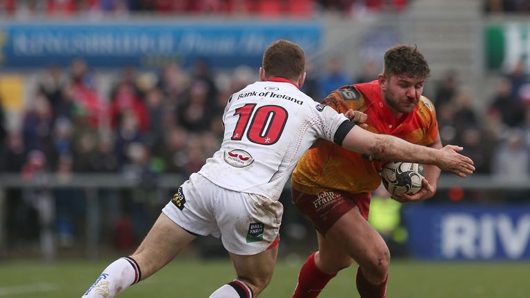 Kirby Myhill is tackled by Ulster's Paddy Jackson