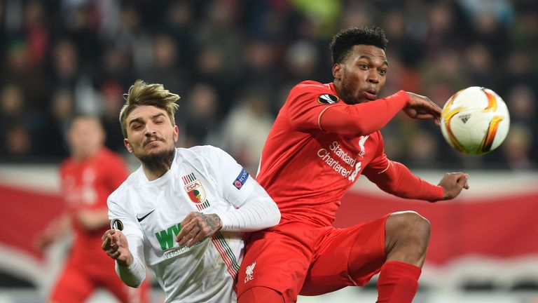 Konstantinos Stafylidis and Daniel Sturridge vie for the ball in Augsburg