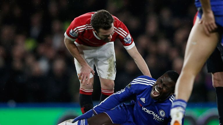 Kurt Zouma clutches his injured knee