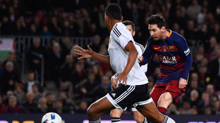 Lionel Messi scores for Barcelona in the 7-0 rout of Valencia