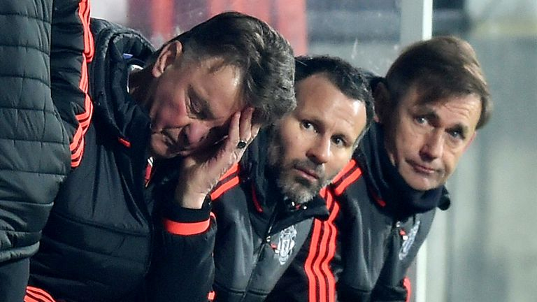 Louis van Gaal (L) casts a frustrated figure on the bench in Denmark.