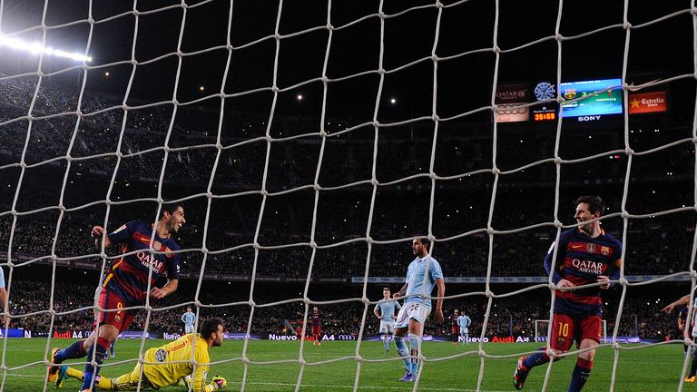 Suarez celebrates his hat-trick goal against Celta Vigo with Messi