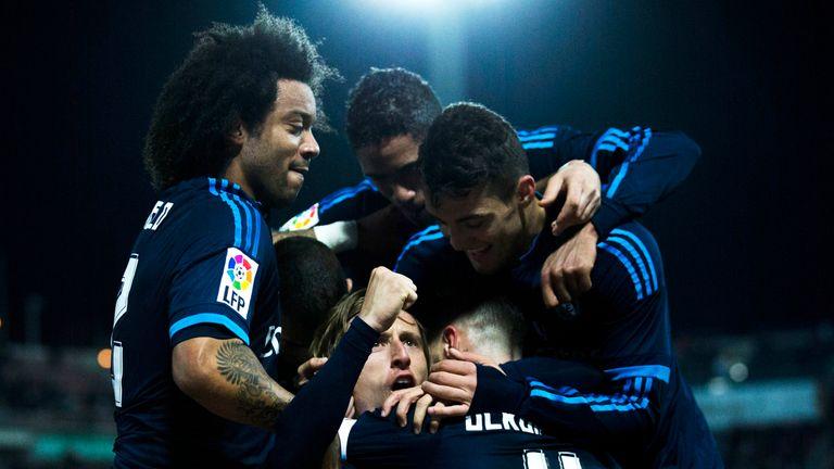 Luka Modric celebrates his winner for Real Madrid against Granada.