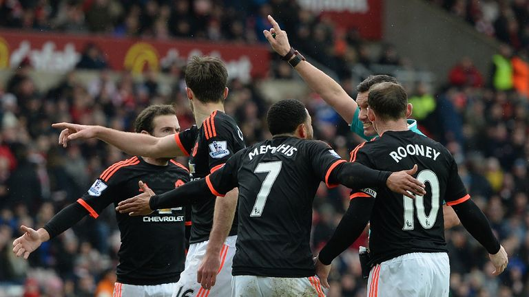 Manchester United players protest a decision at the Stadium of Light