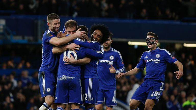 Hazard is congratulated after scoring in the FA Cup against Manchester City