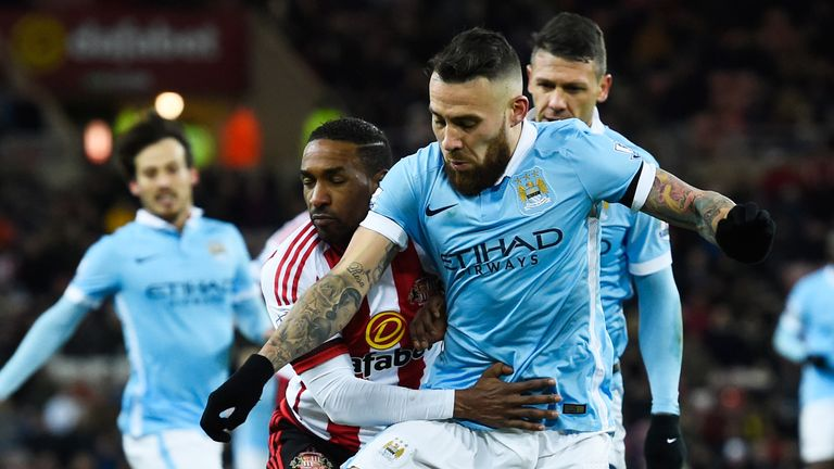 Nicolas Otamendi and Jermain Defoe compete for the ball