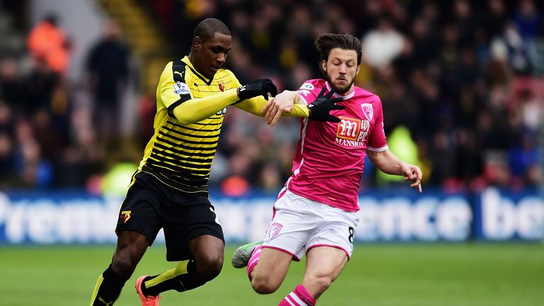 Odion Ighalo of Watford and Harry Arter of Bournemouth compete for the ball