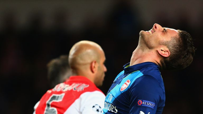 Olivier Giroud shows the strain after last year's tie with Monaco