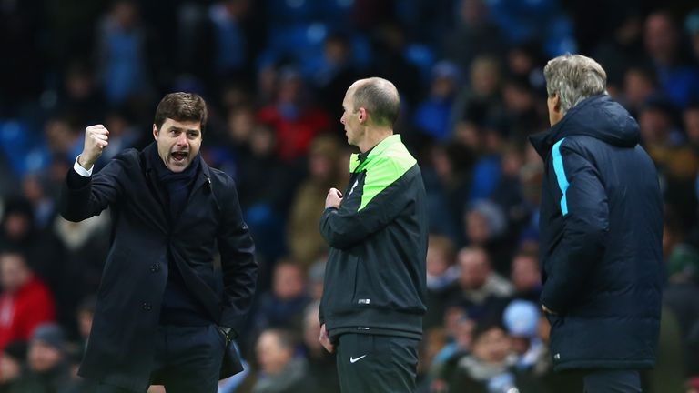 Mauricio Pochettino (l) celebrates Spurs' victory at Man City