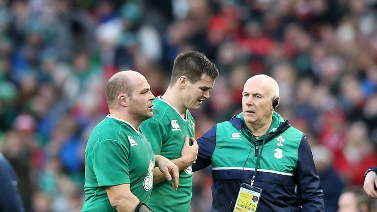 Rory Best consoles an injured Sexton as he leaves the pitch