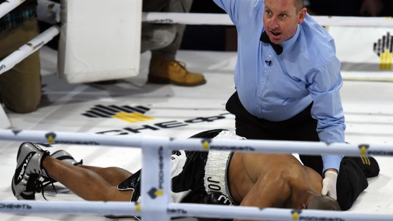 Jones Jr. lies in the ring after being knocked out by Enzo Maccarinelli in December