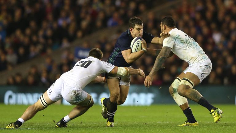 John Hardie is closed down by by Jack Clifford and Courtney Lawes