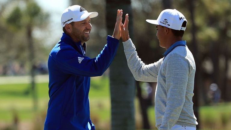 Sergio Garcia (left) celebrates his 148-yard eagle with Rickie Fowler