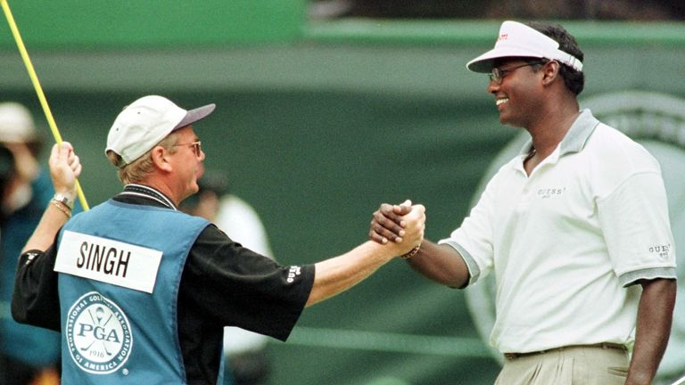 Vijay Singh celebrates with caddie Dave Renwick after PGA glory in 1998
