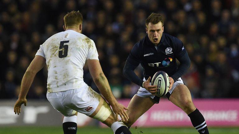 Stuart Hogg takes on England tryscorer George Kruis