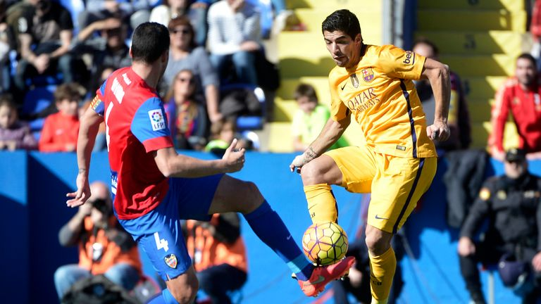Luis Suarez (right) competes for the ball with David Navarro