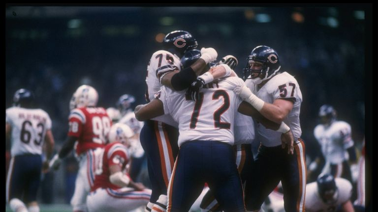 William Perry #72 is swamped by his teammates after scoring