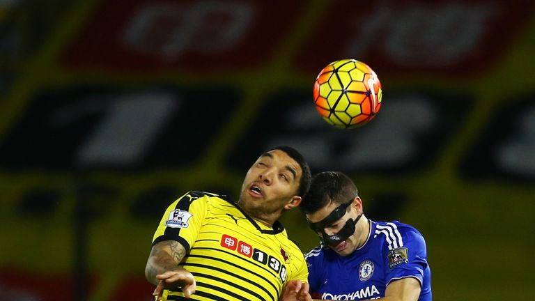 Troy Deeney and Cesar Azpilicueta compete for a header