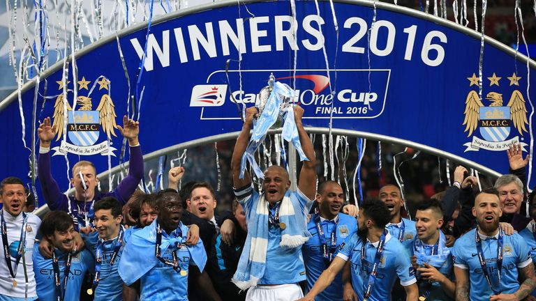 Manchester City's Vincent Kompany lifts the Capital One Cup at Wembley Stadium