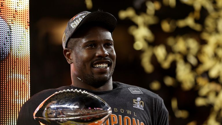 Super Bowl MVP Von Miller #58 of the Denver Broncos celebrates with the Vince Lombardi Trophy