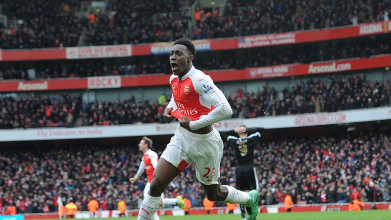 Danny Welbeck celebrates scoring Arsenal's late winner against Leicester