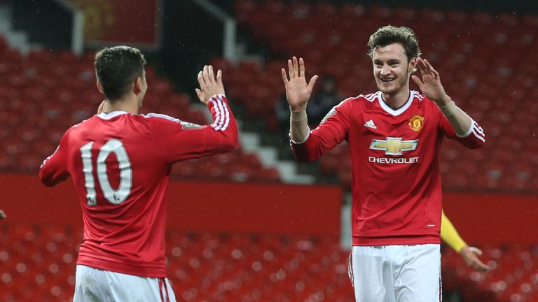 Will Keane (R) celebrates scoring his second goal with Andreas Pereira (L)