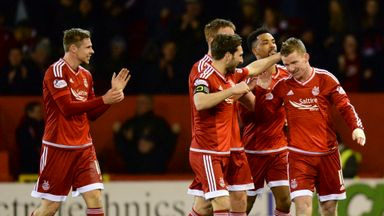 Jonny Hayes (right), Shay Logan (second right) and Graeme Shinnie (with armband) included in team of the year