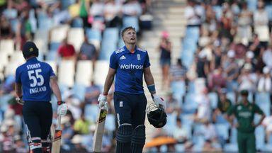 England batsman Joe Root (2-L) celebrates after scoring a century