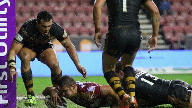 Wigan's Michael McIlorum scores his second try against the Dragons