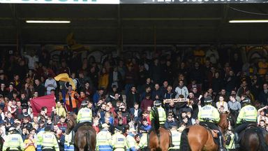 Mounted police on the Fir Park pitch after the play-off against Rangers