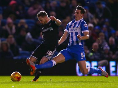 Alan Judge of Brentford is tackled by Lewis Dunk