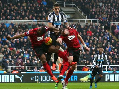 Aleksandar Mitrovic tries to win a header for Newcastle