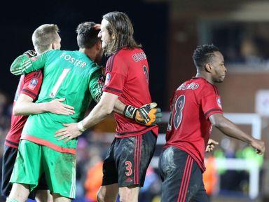 West Brom goalkeeper Ben Foster is congratulated