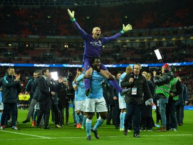 Willy Caballero is lifted up by Wilfried Bony following the Capital One Cup final penalty shootout