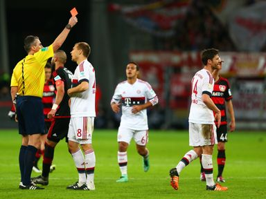 The referee shows a red card to Bayern Munich's Xabi Alonso