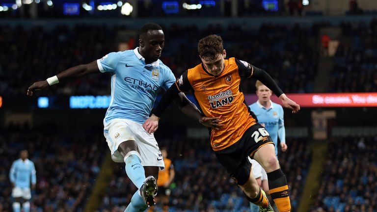 Bacary Sagna (left) is confident Manchester City can overhaul Leicester