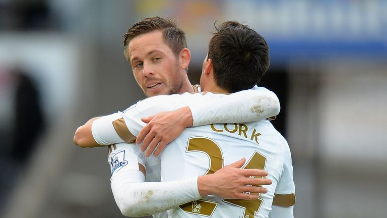 Gylfi Sigurdsson (left) and Jack Cork (right) celebrate Swansea's winning goal