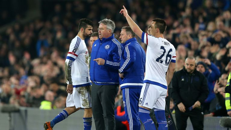 Costa (1st L) of Chelsea walks off the pitch past Guus Hiddink (2nd L) after the red card