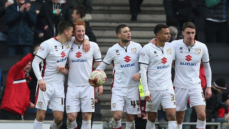 Dean Lewington of Milton Keynes Dons celebrates scoring their first goal during the Sky Bet Championship match between