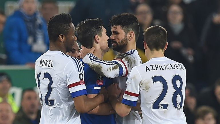 Diego Costa clashes with Gareth Barry in the incident leading to Costa's second yellow card