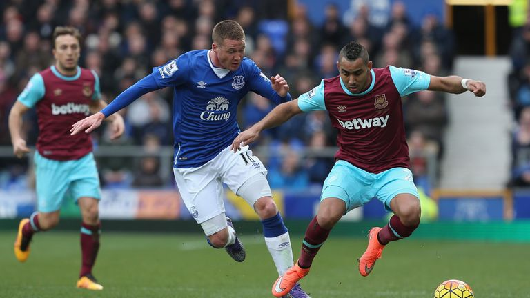 Dimitri Payet tries to get away from James McCarthy