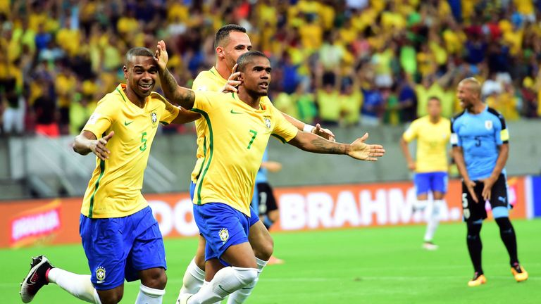 Douglas Costa (No 7) gave Brazil the lead in the World Cup qualifier